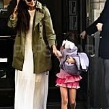 Katie Holmes wore a green trench coat and held Suri Cruise's hand as they left their apartment to celebrate Suri's 6th birthday.