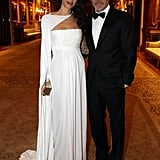 Amal looking like a Grecian goddess in this beautiful white William Vintage caped gown.