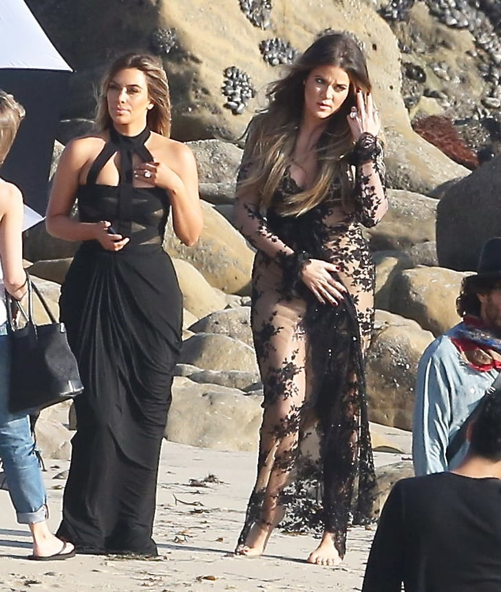 kim kardashian in a black dress at beach popsugar celebrity