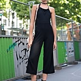 Try out shorter lengths and different tops in a cropped, strappy halter neck jumpsuit.