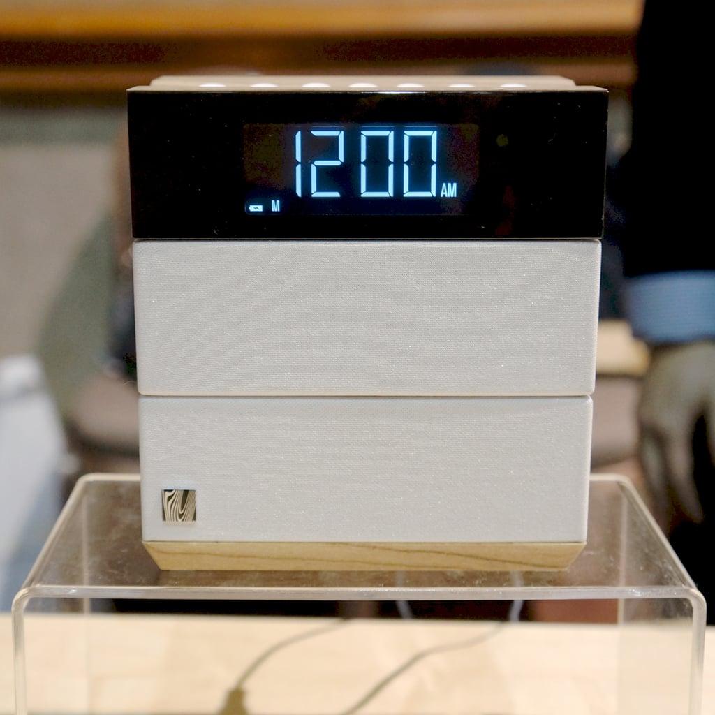 Love the wood-grain detail on the bottom of the white speaker paneling.