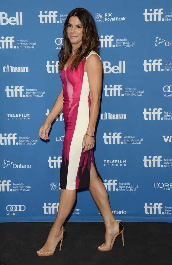 Sandra Bullock chose a multicolored Roland Mouret dress and nude ankle-strap sandals for the press conference of Gravity.