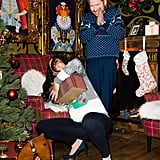 This is the one that really unsettles me. I guess Wax Meghan is retrieving a gift from underneath the tree while Wax Harry, still an inexplicable embarrassment, just watches her. Wax Meghan is clearly having a bit of a hard time with her pregnant belly, and Wax Harry is just unable or unwilling to help.
