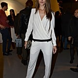 Alessandra Ambrosio rocked a white Iro jumpsuit with a black waistband, a studded clutch, and black pointy pumps at a party in West Hollywood.