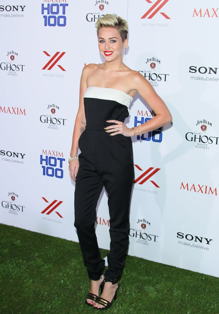 Miley Cyrus flashed her engagement ring at the Maxim Hot 100 party.