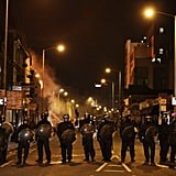 Police officers line the streets during the London riots.