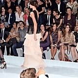 Orlando Bloom checks out his wife Miranda Kerr on the runway!