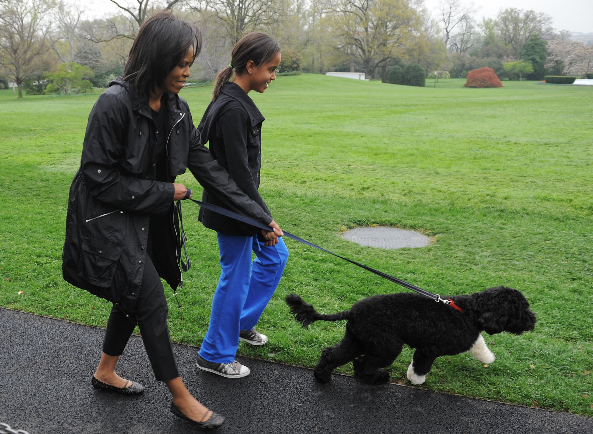 In April 2009, Michelle and Malia took the newest addition to the family — Bo Obama — for a walk.