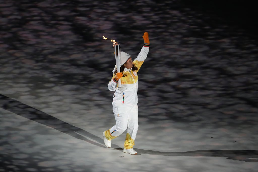 A torchbearer entered the stadium.