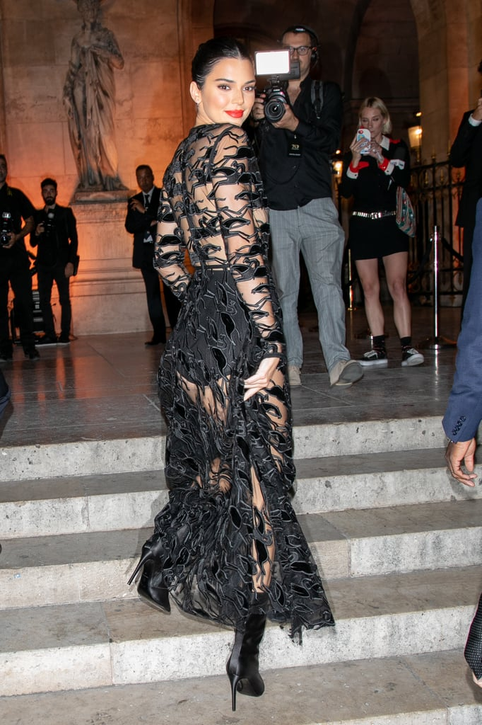 Can someone pass the ice water, please? *Gulp* Kendall Jenner stepped out in Paris on Sept. 11 wearing a sheer, detailed black dress. The 22-year-old model is certainly no stranger to a see-through outfit, and this latest look leaves very little to the imagination.  After leaving New York Fashion Week early, Kendall touched down in Paris to help celebrate Longchamp's 70th anniversary. She wore a floor-length Longchamp gown for the occasion, and although the dress features a plunging neckline, her look might be even sexier from the back. While the leggy model went see-through nearly everywhere else, she paired the sultry dress with opaque midcalf pointed boots. Keep reading to see more angles of her custom gown.       Related:                                                                                                           Kendall Jenner Found the Perfect Shoes to Make Her Supermodel Legs Look Even Longer