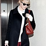 Emma Stone wore a black coat.