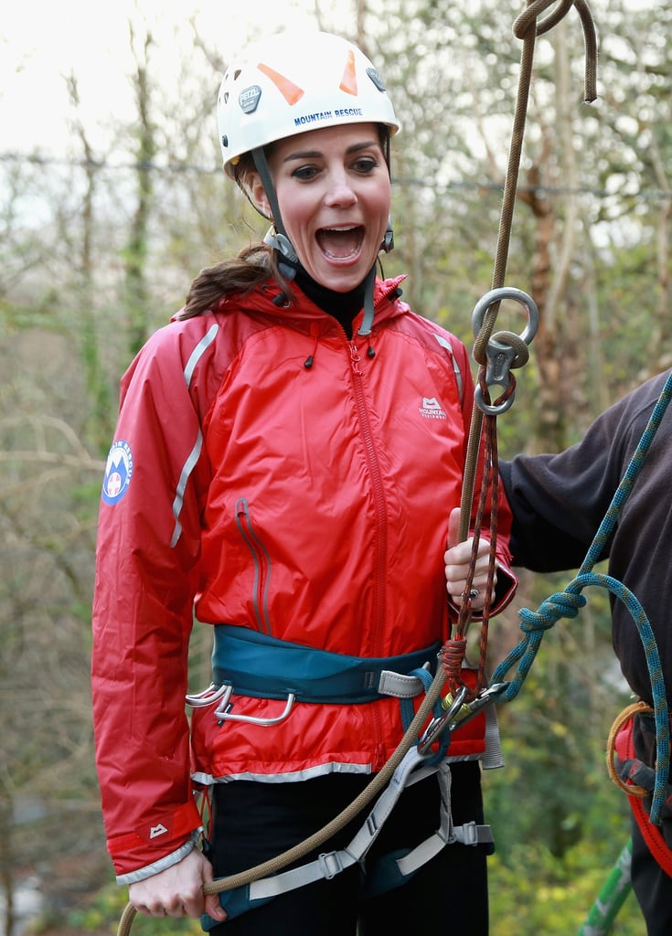 Prince William and Kate Middleton visited the Towers Residential Outdoor Education Centre in Capel Curig, UK, on Friday. The royal couple met with a team of mountain rescue personnel at the outdoor center, which helps provide adventure activities for children. Kate and Will were all smiles as they suited up in climbing gear — William looked so cute helping Kate with her straps! — and joined a group of staff and kids to do some rock climbing. Kate seemed to be having a ball, first looking a little nervous before getting into the groove; she inadvertently re-created her own childhood photo as she scaled the wall, making for a sweet, nostalgic moment.  Before their rock-climbing adventure, Will and Kate met with organizations supporting young people and tackling mental health issues in North Wales. Kate stunned in a dark coat and boots and shared a laugh with the crowd of kids, including one little boy who adorably handed her a bouquet. Keep reading to see all the photos from Will and Kate's day in the UK, then look back at all the times Kate wasn't too princessy to play sports.