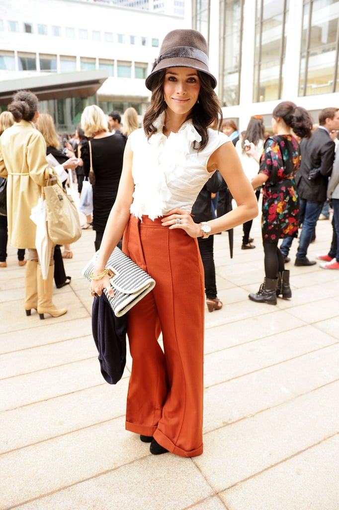 For a Fashion Week event, Abigail looked chic in orange high-waisted trousers.