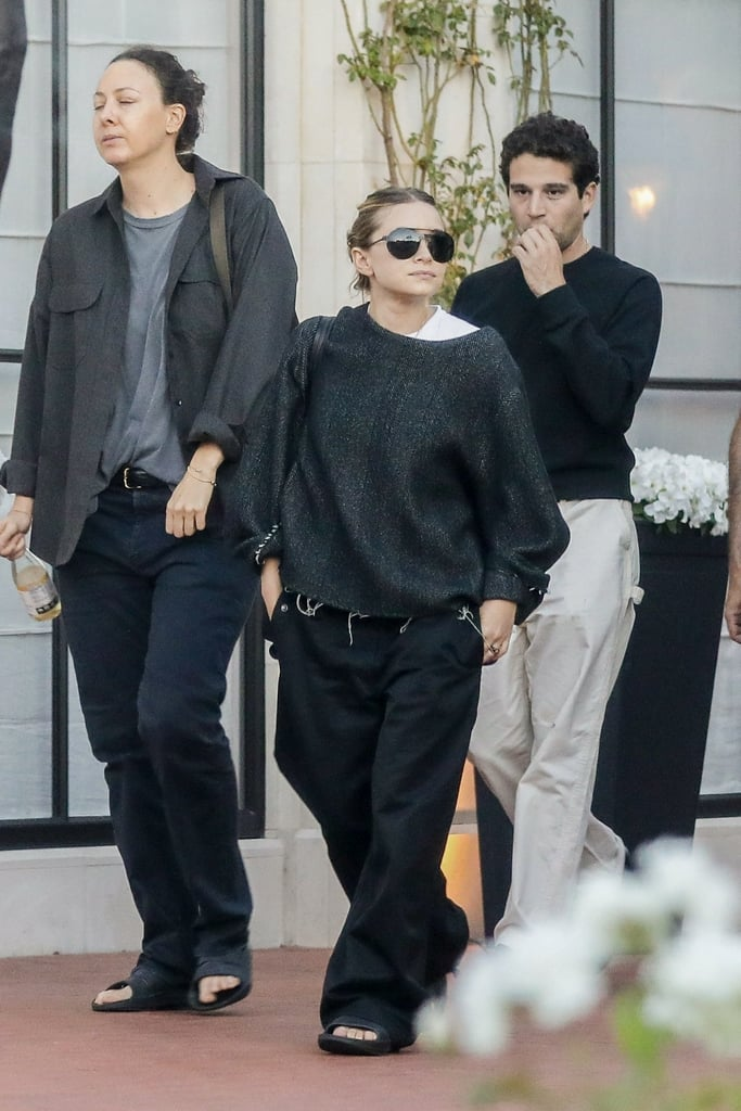 Ashley Olsen Wearing Black Trousers and Slides to the Movies