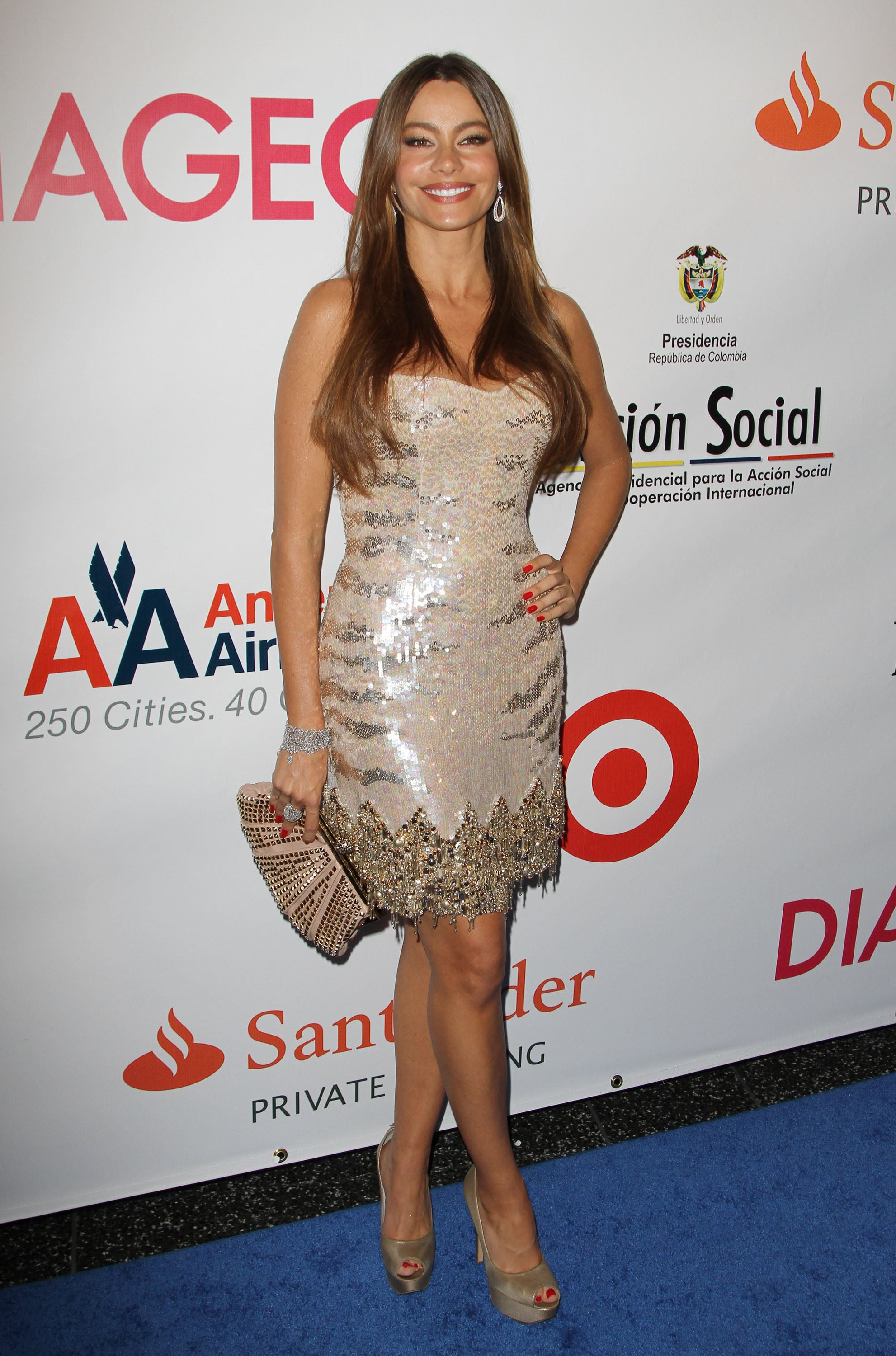 Sofia Vergara sparkled in a glistening beaded and fringed Roberto Cavalli minidress, champagne-colored pumps, and a studded clutch at a 2011 BeLive celebration in Miami.