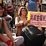 This woman in Hong Kong held a sign protesting capitalism.