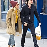 Sienna Miller wore a wool cap and yellow top.