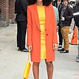 While out in NYC, Solange Knowles took bright to a whole other level in a yellow sheath dress, topped with an orange coat and finished with yellow pumps, a yellow wristlet, and gold glittery Miu Miu sunglasses.