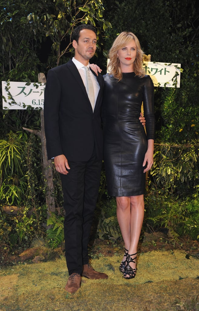 Charlize Theron and her Snow White and the Huntsman director Rupert Sanders posed together during a press event in Tokyo today. Charlize chose a fitted leather dress for the occasion, which comes after a string of appearances in London, Berlin, and Madrid with her costar Kristen Stewart. The duo recently split up to continue promoting their project with Kristen popping up in Mexico City just yesterday. Charlize still has a traveling companion, though, since her son, Jackson, has been joining her on the road. Charlize talked about Jackson in our recent interview with the star, saying that she'll be excited to share fairy tales and classic stories with him in the future.
