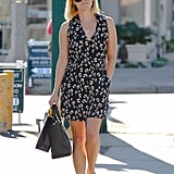 Reese was the epitome of casual chic in a printed wrap dress and studded Valentinos while shopping around LA's Brentwood neighborhood.