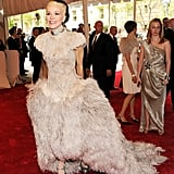 Daphne Guinness made a showstopping appearance in a feathery creation by the late designer. She topped off her look with tassel earrings and sky-high silver platforms.
