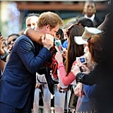 Harry was embraced by a well-wisher while attending the 50th anniversary screening of Zulu at Odeon Leicester Square in 2014.