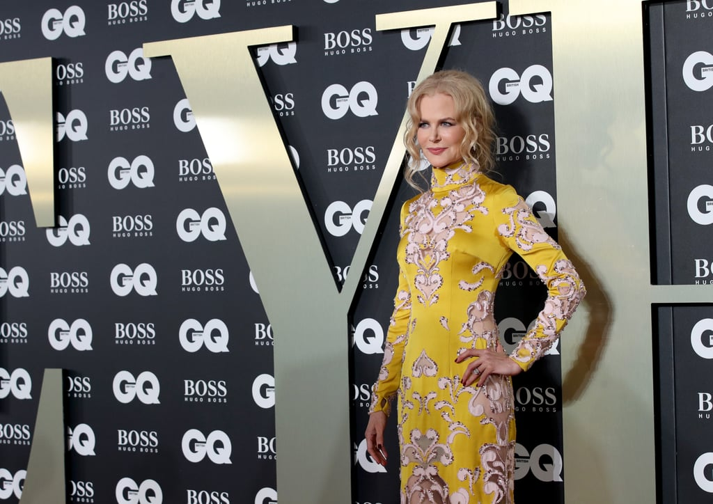 "Nicole Kidman made a glamorous appearance at the GQ Men of the Year Awards in London on Tuesday night, as she picked up the actress of the year award for her work on Big Little Lies. The Aussie actress chose a fitting look for the evening, opting for a look by British-based couturiers Ralph & Russo. The column gown, from the Fall 2019 couture collection, is described by the designers as a ""mustard yellow silk double satin gown hand embellished with pale pink silk crêpe swirls and sheer tulle cut-outs in an Art Deco design, enriched with rosaline stones and rosewater opal crystals, finished with pale pink mink fur pom poms."" Phew! At first glance, this high-necked, long-sleeved gown feels like quite a restrained, modest choice, but if you take a closer peek, you'll see that all those sheer tulle panels reveal flashes of skin, putting a high-fashion spin on the ubiquitous naked dress. It's a grown-up way to wear the red carpet trend that just won't die, and we think you'll agree Nicole was born to wear this statement gown. Keep reading to take a closer look and to see Nicole hanging out with other stars like Elle Fanning and Kylie Minogue as she enjoys her big night.      Related:                                                                                                           Nicole Kidman Plans to Shock You With Her Oscars Dress"