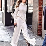 For a Winter day in NYC, Gigi stayed warm in a Stephanie Rad oversize collar turtleneck with matching cream-colored pants. The bottoms had a side slit to show off her snakeskin boots.