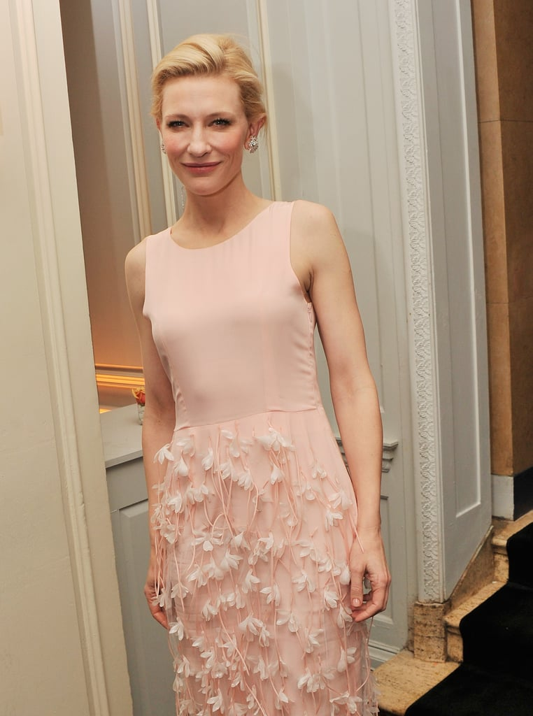 When Cate removed the cape inside, she revealed an understated top.