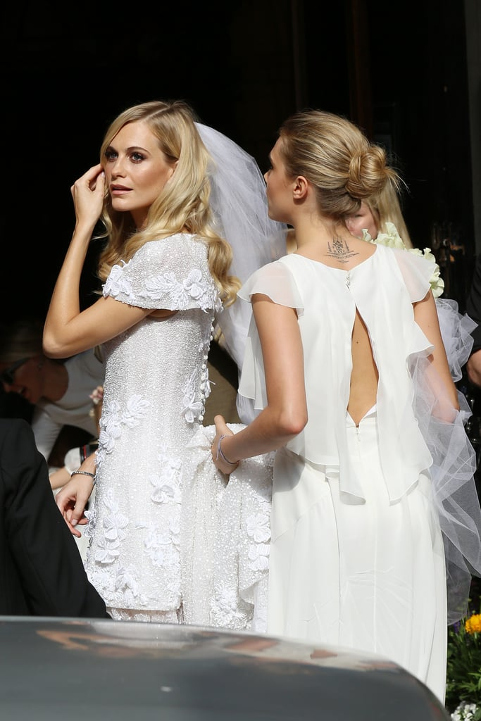 "Poppy Delevingne married her longtime partner James Cook at St Paul's Church in Knightsbridge, London, on Friday. The bride looked stunning in a custom-made Chanel Haute Couture gown — the model is especially close to the brand's designer, Karl Lagerfeld — while younger sister Cara Delevingne wore an equally gorgeous white Chanel dress. Cara played the role of the doting maid of honor, holding on to Poppy's gown and helping her enter the church, and Poppy shared a sweet smooch with her brand-new husband after tying the knot. Guests at the nuptials included former Spice Girl Geri Halliwell and fashion designer Matthew Williamson, but sadly missing was Poppy's BFF Sienna Miller, who is currently filming American Sniper with Bradley Cooper in LA. It sounds like Sienna will have another chance to see her friend get hitched, though: it's been reported that Poppy is also having a ceremony later in the year in Morocco, which will be a lavish black-tie bash. Poppy broke the news of her engagement to James last year by tweeting a photo of a bespoke red jewelery box by Anya Hindmarch with ""Will you marry me?"" etched on the inside. She shared photos of the gorgeous engagement ring soon after. Scroll through to see all of the beautiful photos. Congrats to the happy couple!"