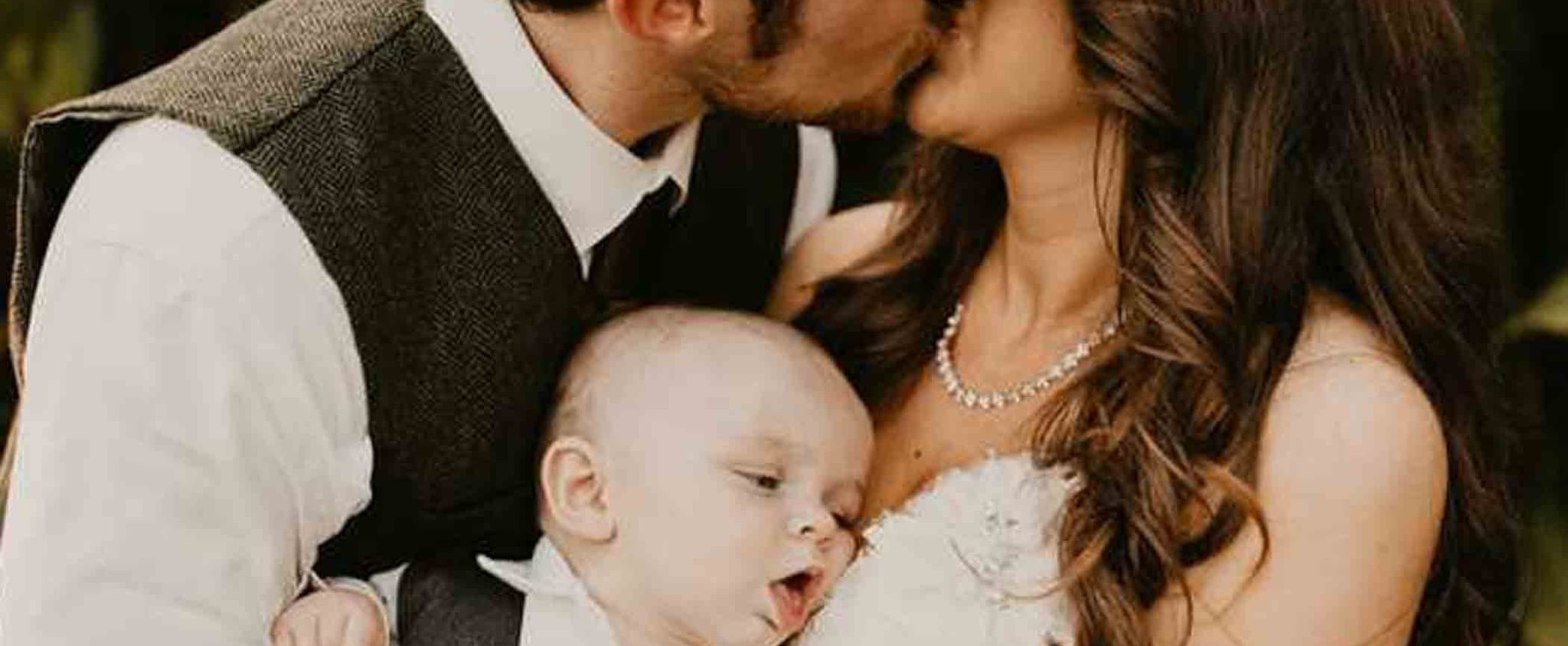 Baby Trying to Breastfeed in Mom's Wedding Photo
