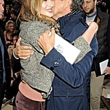 Rosie Huntington-Whiteley hugged Mario Testino at Burberry.
