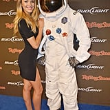 Candice Swanepoel, who hung out with a Bud Light astronaut in New Orleans, supplied the leggy appeal via this thigh-high split LBD — as for her shoe choice? We've never seen a sexier pair of nude pointy-toe pumps before.