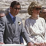 Princess Diana opted for the brown pair of aviators while on tour in Italy, styling the shades with a simple floral day dress, belted in at the waist.