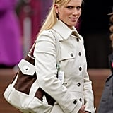 Zara looks smart casual in a pale coat with an oversized shoulder bag.