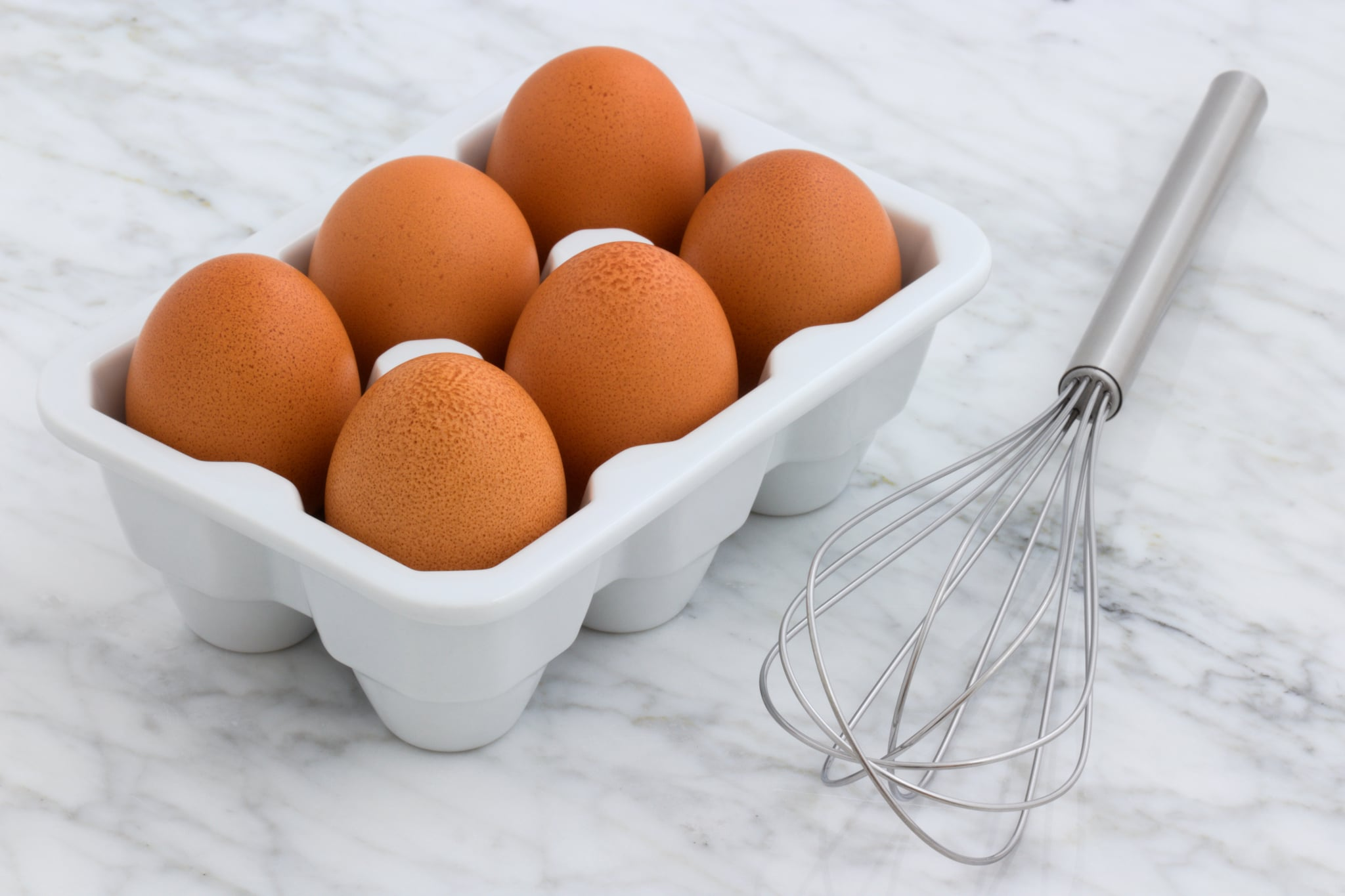 tmp_tjweES_e2e1f5b5f80d4bf5_six-brown-eggs-with-tray-2959303.jpg