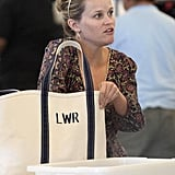 Reese Witherspoon carried a tote bag with her at the airport.