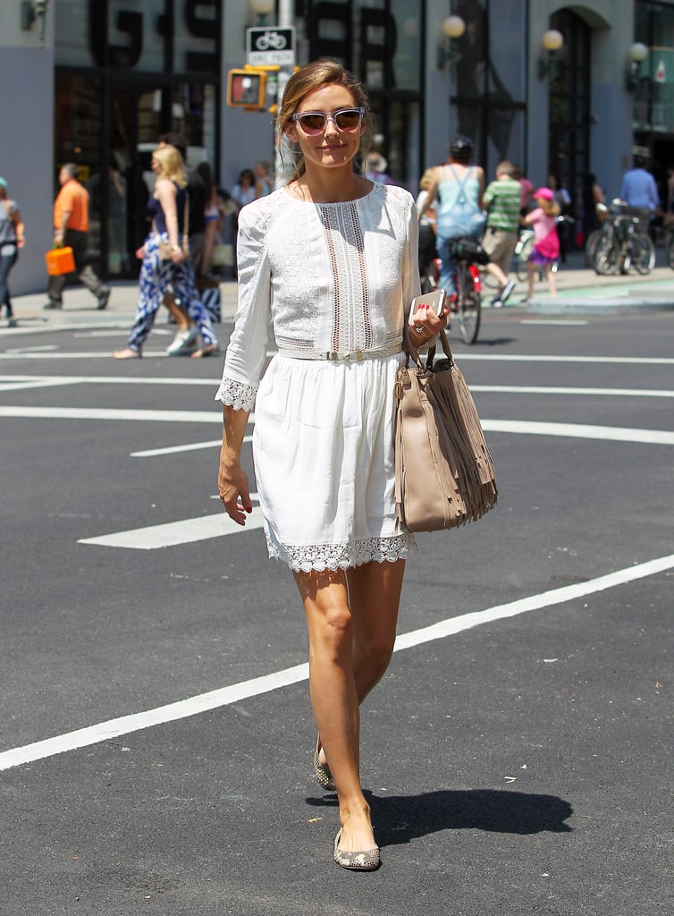 Olivia kept her daytime look demure in a white frock and feminine flats.