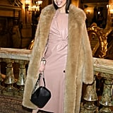 Wearing a blush Stella McCartney dress and faux fur coat at the Stella McCartney show during Paris Fashion Week in March 2019.