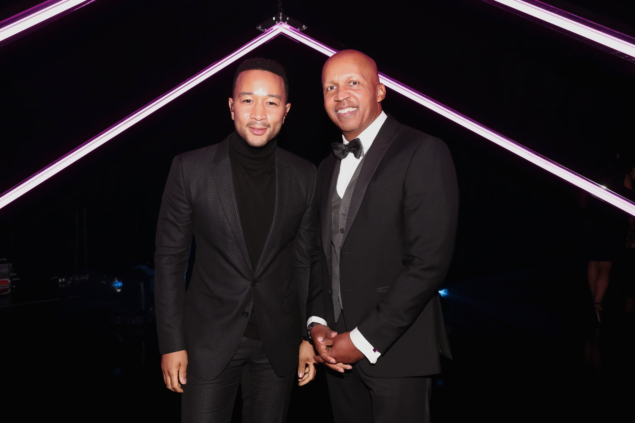 SANTA MONICA, CA - NOVEMBER 11:  2018 E! PEOPLE'S CHOICE AWARDS -- Pictured: (l-r) Recording artist John Legend and People's Champion Award honoree Bryan Stevenson pose during the 2018 E! People's Choice Awards held at the Barker Hangar on November 11, 2018 --  NUP_185072  --  (Photo by Christopher Polk/E! Entertainment/NBCU Photo Bank via Getty Images)