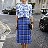 Laura Bailey is a master of mixed prints — her floral button-down and tartan plaid midi skirt look like a match made in fashion heaven.