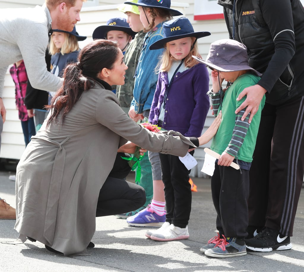 "Meghan Markle and Prince Harry are currently on the final leg of their royal tour of Australia and New Zealand, and the cute moments just keep coming! After visiting the Maranui Cafe in Wellington on Monday, the mom-to-be handed out some sweet treats to a group of kids from Houghton Valley School waiting outside to meet her and Harry. ""They asked us what our names were and also they were really nice and just talked normally to us,"" one of the students told TV NZ. ""My legs were shaking so much,"" another kid added.  In fact, one child in particular, 5-year-old Joe Young, was so overwhelmed with emotion that as Meghan approached him, he began sobbing. Meghan, being the angel she is, comforted Joe by patting his stomach and taking a look at a flag he made. Yep, Meghan is going to make an amazing mom.       Related:                                                                                                           10 Moments From Harry and Meghan's Tour That Show They're Going to Make the Best Parents"
