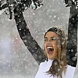 A Philadelphia Eagles cheerleader braved the snowy weather during the team's game against the Detroit Lions in Pennsylvania.