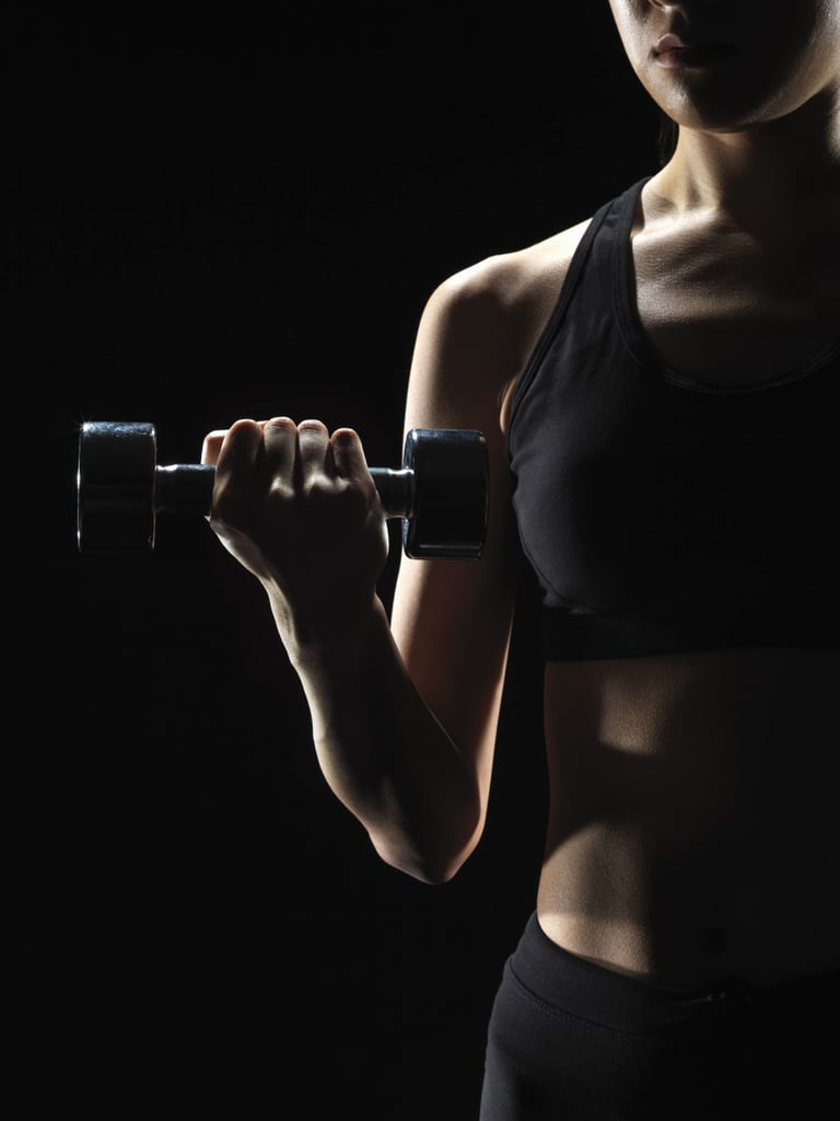 Grab a Set of Dumbbells For This Total-Body HIIT Workout to Fight Belly Fat