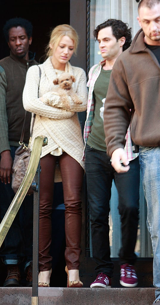Blake Lively held onto her constant companion, Penny, leaving the set with Penn Badgley in November 2011.