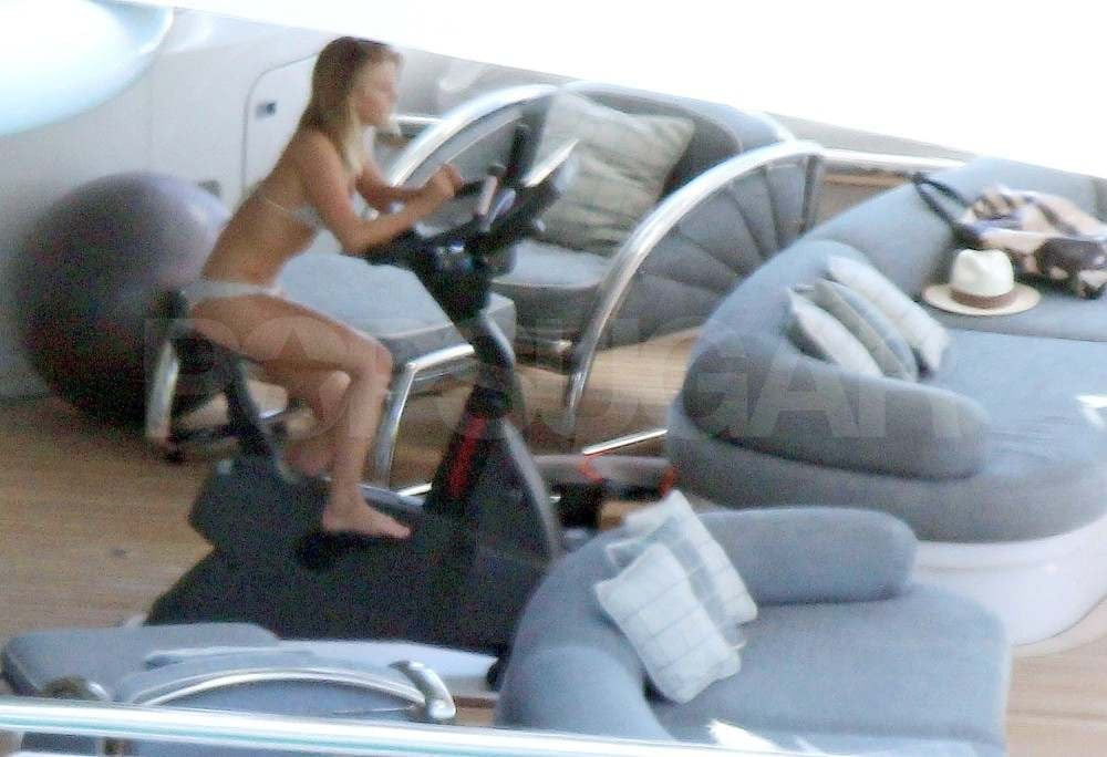 Julianne Hough riding a bike in her bikini.