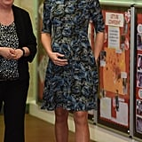 The duchess was only two months away from giving birth to Princess Charlotte when she stepped out on Feb. 18 in a printed dress by Seraphine with black pumps . . . though from the looks of it, she wasn't nearly about to pop!