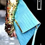 What's more stunning? The gold sleeve or turquoise clutch? We think both.