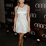 Stacy Keibler kept her style sweet and playful at the Audi Super Bowl party in a metallic-printed minidress and nude sandals.