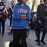 Wear a Frilly Skirt With a Collegiate Sweatshirt and Converse